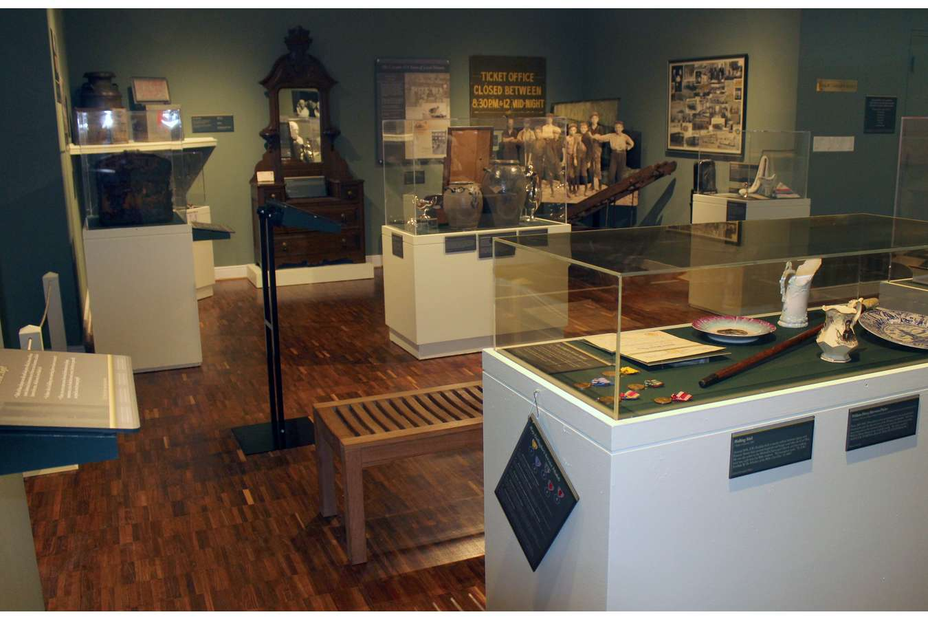"4 Lycem : Display Case layout with ""Docent Card"" interpreting case artifacts"
